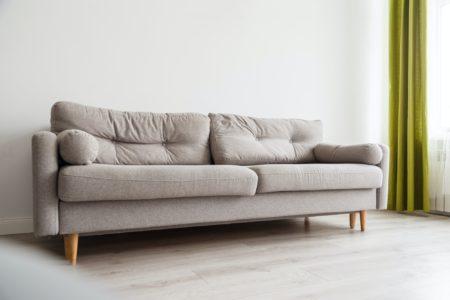 Grey sofa in monochromatic living room
