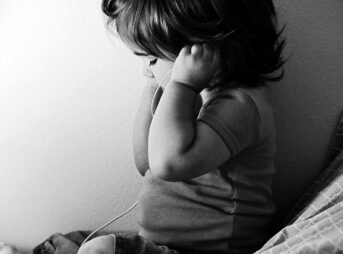 Toddler listening to music on headphones